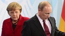 Путин за закрытыми дверями переговорил с Меркель и Юнкером